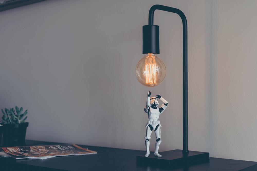 Figurine with a light bulb indicating creativity.