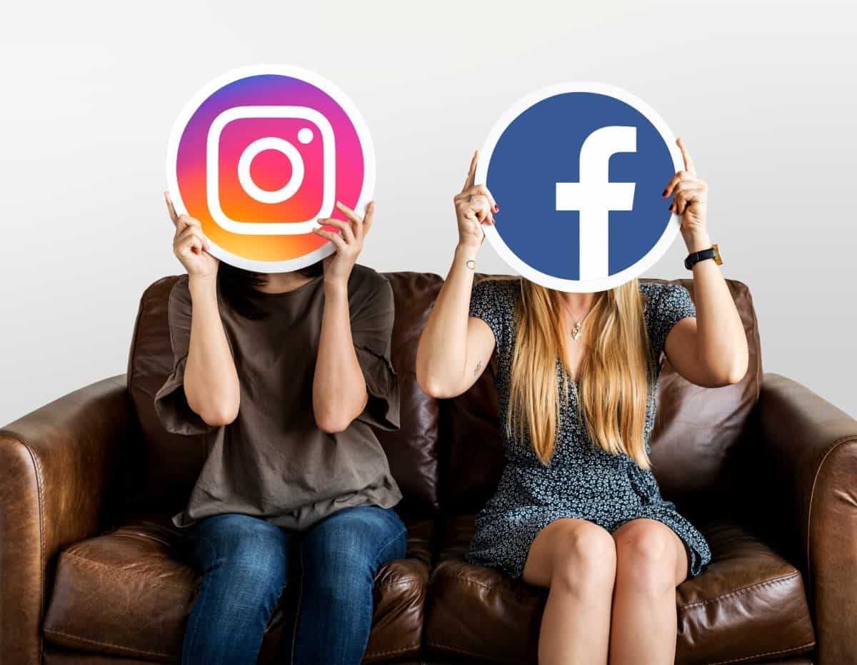 Two woman holding Instagram and Facebook logos