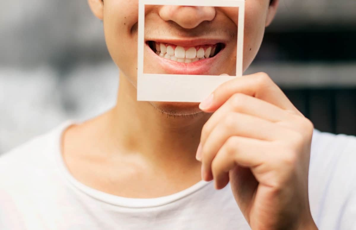 Smiling man showing personality for youtube