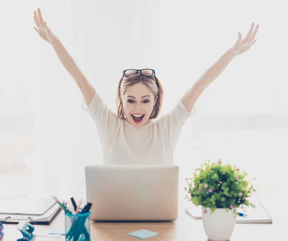 Excited woman about learning how to start a blog