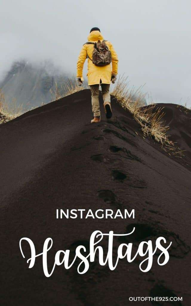 Instagram Hashtags Pin Man with yellow jacket on black sand